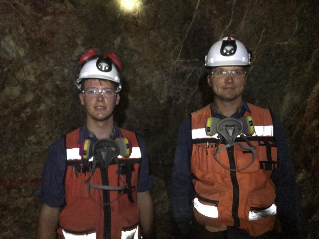 Two men in an underground tunnel.