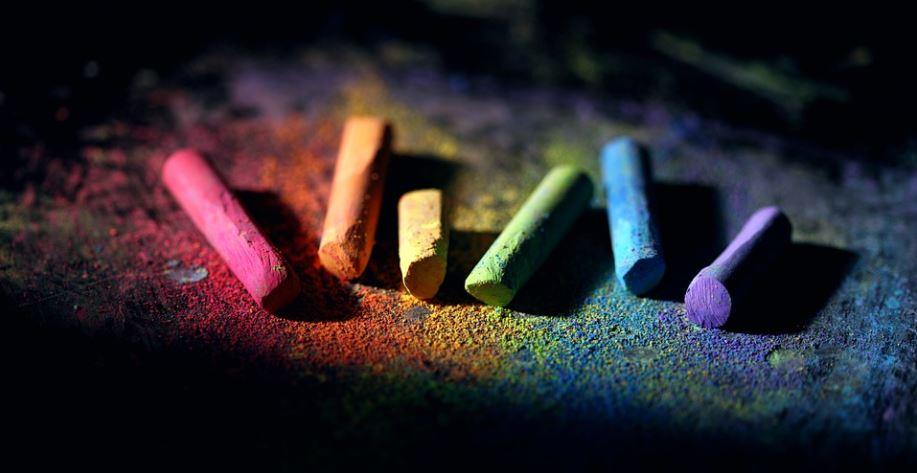 multi-coloured chalk and dust arranged like a rainbow